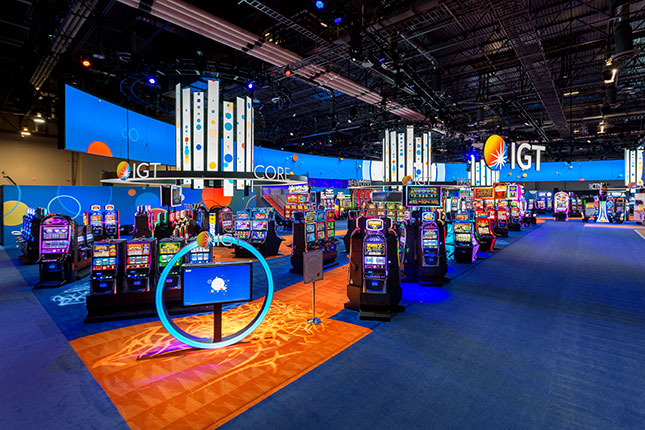 An elevated perspective of slot machines and video chandeliers at the IGT booth at G2E 2016.